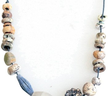 Spathes cemetery: Necklace with twenty eight amber beads of Mycenaean Age