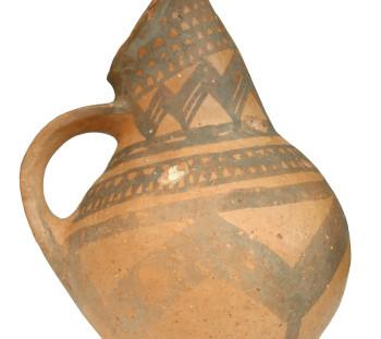 Tombs cemeteries in the broader Olympus region of Dion: Handmade matt-painted beaked jug of Early Iron Age