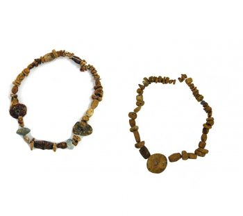 Spathes cemetery: large amount of amber beads and three light blue glass beads from a grave of Mycenaean Age